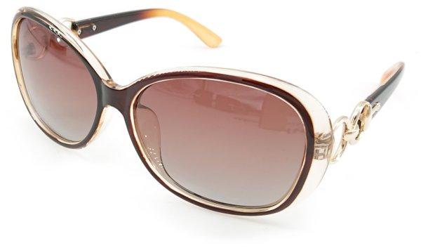 På billedet ser du variationen Sheeny, dame solbriller med etui fra brandet Barcur i en størrelse H: 5,3 cm. B: 5,9 cm. i farven Brun